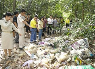 Village Chief Watcharee Vichiensakulchot (left) leads residents and workers to clean up after the typically irresponsible behavior of leaving garbage in their national park.