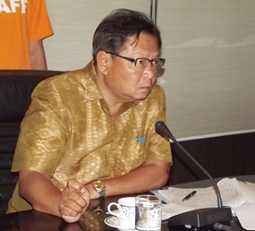 Chonburi Deputy Gov. Adisak Thepass listens to progress reports on the 90-day x-ray mission.