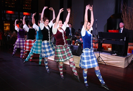 Scottish dancers spice up the evening to thunderous applause.