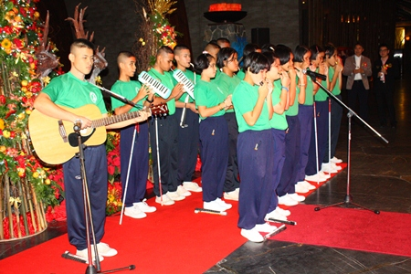 Students from the Pattaya Redemptorist School for the Blind play Christmas music during the lighting of the Christmas tree at Centara Grand Mirage Beach Resort Pattaya.