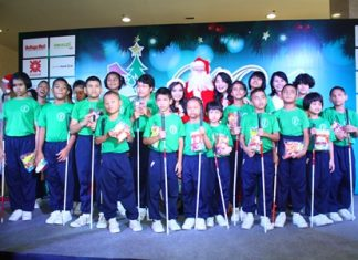 Children from Redemptorist School for the Blind receive sweets from Santa and his helpers.