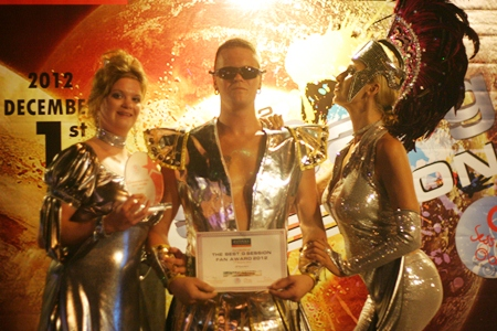 "More winners of the ""Outstanding Fan G 2012"" award parade their costumes."