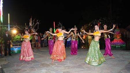 Hotel employees perform a dance from the Sukhothai period, much to the delight of the audience.