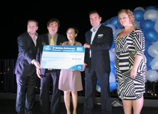 (L to R) Gerard Walker, Ronakit Ekasingh, Philippe Kronberg and Peta Ruiter present a cheque of 66,930 baht to Radchada Chomjinda (center).