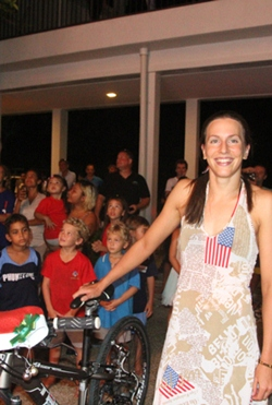 Triathlon Olympian Radka Vodickova span the pedal-powered generator to light up the tree.