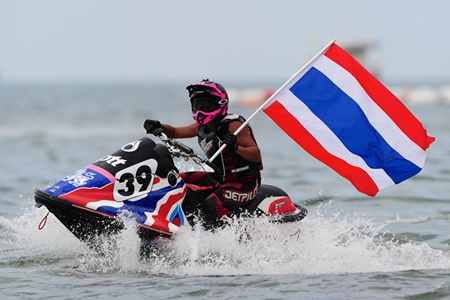 Teera Settura flies the flag after winning another race. (Photo/www.jetski-worldcup.com)