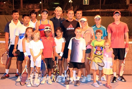 The Russian tennis star is pictured (centre) with the participants of the Fitz Club Tennis Master Class after an energetic and productive session.