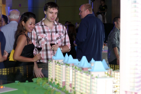 Guests view a scale model of the Grande Caribbean Condo Resort.