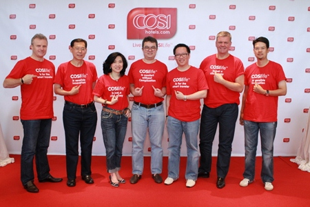 Staff and management of Centara Hotels & Resorts including Chief Executive Officer Thirayuth Chirathivat (center) and Vice President of Business Development, Suparat Uahwatanasakul (3rd right), pose for a photo in Bangkok during the official launch of the COSI Hotels brand.