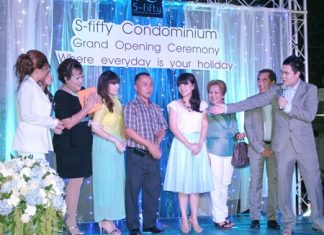 Pongsathast Jiraprasertsuk, executive of S-Fifty Condominium (right) introduces the project's executive team at the Phase 2 launch party held Dec. 15.