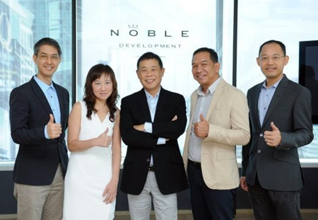 Kitti Thanakitamnuay, Chairman and CEO of Noble Development PLC (center) poses with other Noble directors at the announcement of the company's plans for 2013.