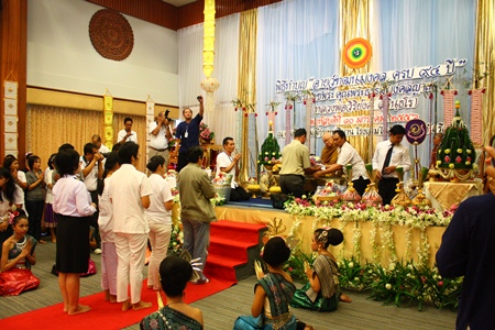 Devotees line up to make their offerings.