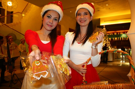 Santarinas distribute gingerbread men during Christmas at Holiday Inn.
