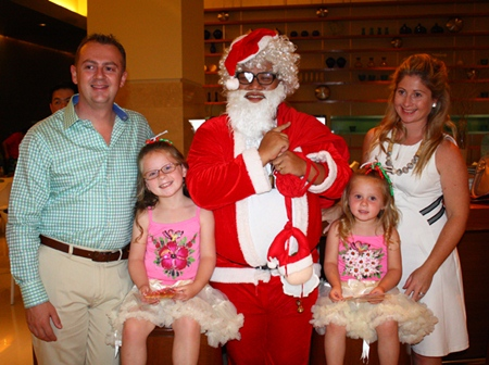 Holiday Inn General Manager Garth Solly (left) and his family pose with Santa for Christmas.