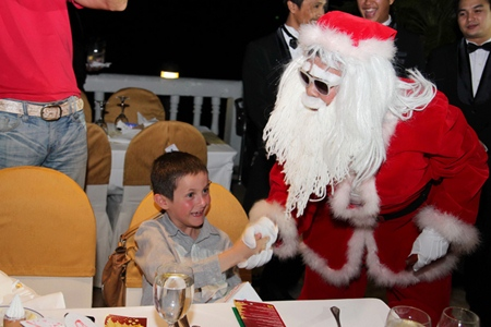 This boy is truly excited to meet Santa Claus at Dusit Thani Hotel, Pattaya.