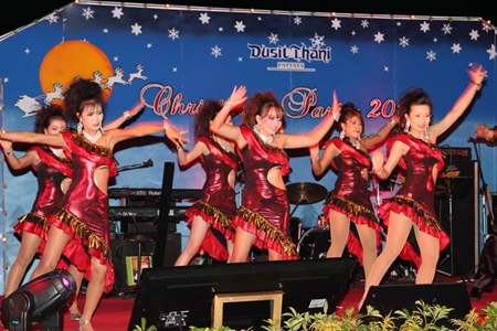 Women dress in their best Christmas outfits to perform their special show at Dusit Thani Hotel, Pattaya.