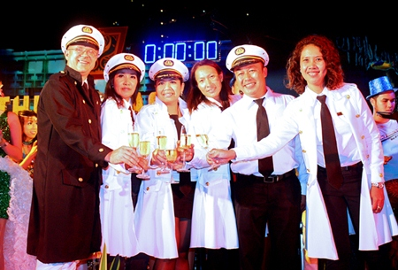 Andre Brulhart, general manager of Centara Grand Mirage Beach Resort Pattaya, rings in the New Years with his administrators sharing the bubbly on January 1, 2013.
