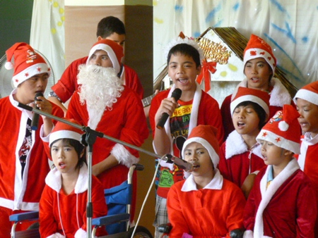 Camillian kids with disabilities singing Christmas carols at the Camillian Home.