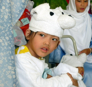 Fahsai plays a sheep in the nativity story at the Camillian Home in Lat Krabang.