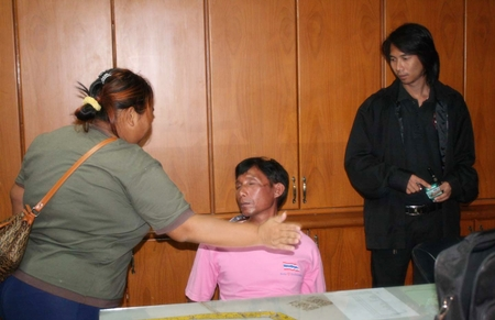 Peng Chanatlay (seated) receives a slap on the face from his now ex-girlfriend, mother of the child he stands accused of raping.