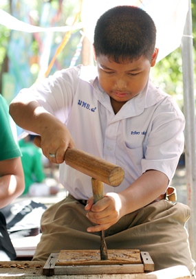 A future sculptor concentrates on his wood carving at the Sanctuary of Truth.