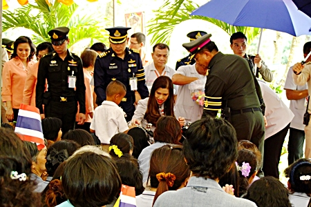 HRH Princess Chulabhorn (center) smiles as she meets one of the children during her visit to the Princess' Mother Medical Volunteer Foundation.