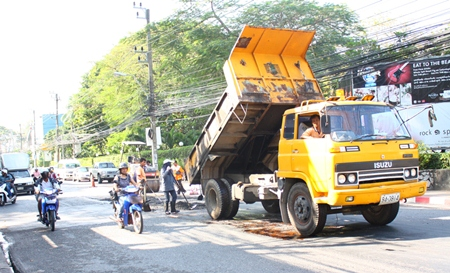 """Pattaya's """"pothole patrol"""" fills holes and levels surfaces along Second Road."""