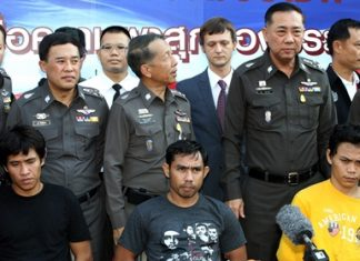 Sitting from left, Anuwat Wat-Onn, 32, Wichen Jaija, 35, and Thongchai Jandee, 20, have been arrested on rape and robbery charges. (AP Photo/Apichart Weerawong)
