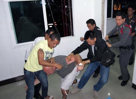 Extra police rush in to help subdue the drunken Belgian.