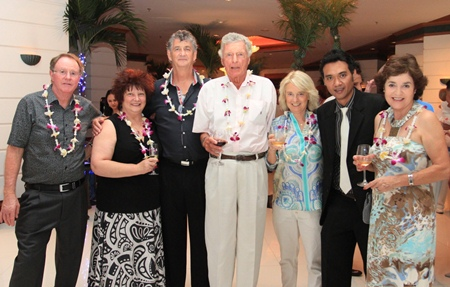 Royal Cliff Grand Hotel's Deputy Resident Manager Kritayos Setteemud is enjoying a glass of wine with a group of regular guests, from left: Mr. Earnshaw, Mrs. Blogg, Mr. Blogg; from right: Mrs. Earnshaw, third from right Charlotte Louise Andrina Waddington & fourth from right Robert Lincoln