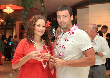 "Regular Guests Luulea Laane-Tuupola and Mika Jaakko Henrik Tuupola enjoy a refreshing fruit punch and the tropical ""Beach Party"" theme!"