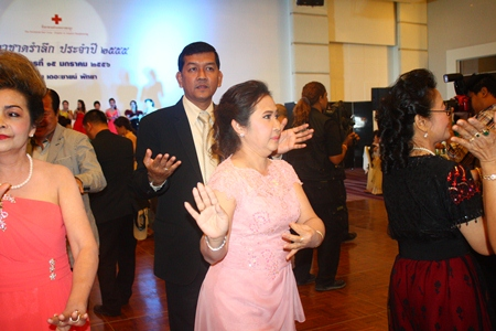 During her last night as Red Cross president, Nuanjan Saeng-Uthai (center) dances with husband Chaowalit, who took over the Chonburi Permanent Secretary post earlier this month.