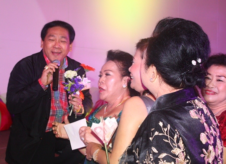 Chanyuth Hengtrakul woos the ladies and receives flowers during his performance.
