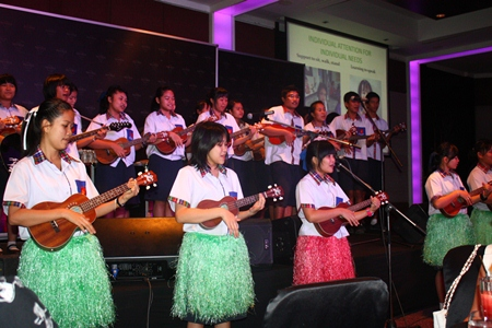 Students from Mechai Pattana School give rousing ukulele performance.