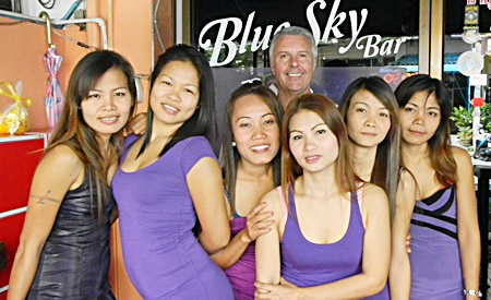 Mike 'Michelle' Chatt (center rear) poses with the staff at Blue Sky Bar.