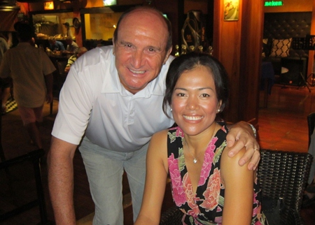 Ladies Champion Ning Neal (right) with husband David.