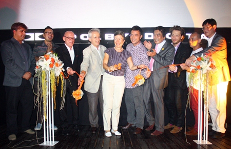 Catherine Viteau (center) cuts the ribbon to officially open the month long movie festival.  Catherine is flanked by husband and French Ambassador to Thailand Thierry Viteau, Ronakit Ekasingh, deputy mayor of Pattaya, Serm Phenjati, owner of the dusit D2 hotel, movie producer Regis Ghezelbash, Kriengsak Silakong, Director of the World Film Festival of Bangkok, Prasong Nitinavakorn, Shop Operations Manager for King Power Pattaya, and Tony Malhotra, Deputy Managing Director, Pattaya Mail Media Group