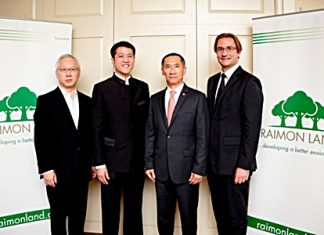 (From left) Raimon Land Directors Johnson Tan and Lionel Lee pose with company Chairman, Pradit Phataraprasit, and Chief Executive Officer, Hubert R Viriot.