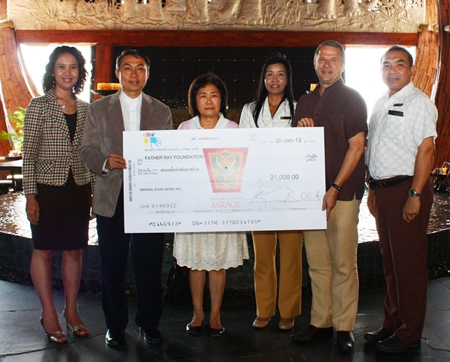Andre Brulhart (2nd right), GM of Centara Grand Mirage Beach Resort Pattaya presents a donation of 25,000 baht to Rev. Peter Pattarapong Srivorakul (2nd left), President of the Father Ray Foundation in Pattaya and Ajima Chavalit-Thamrong (3rd left), Fundraising Manager. The funds were raised during the hotel's 3rd anniversary celebrations and annual Christmas Tree Lighting Ceremony in 2012. Other staff members at the presentation included Usa Pookpant, Public Relations Manager; Sukanya Wongdornma, Financial Controller and Wuthisak Pichayagan, Executive Assistant Manager F&B.