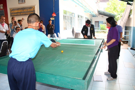 City councilman Rattanachai Suthidechanai tries his hand at table tennis with a blind student.