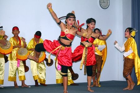 Girls from Pattaya School No. 7 give a traditional Thai boxing dance demonstration to the beat of boys playing the long drums.