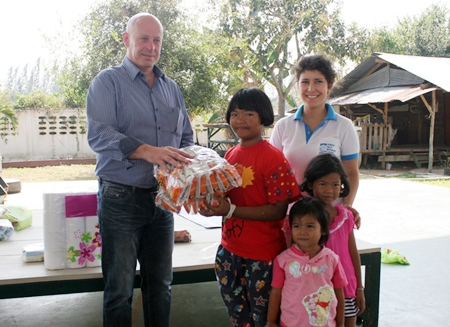 Tulip Group's business development chief Keith Fathers presents some much needed food items to children at the CPDC.