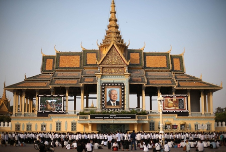 Thousands of mourners gather at the Royal Palace and wait in line to pay their respects in Phnom Penh, Saturday, Feb. 2. (AP Photo/Wong Maye-E)