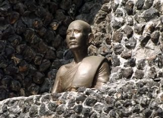 A statue of Provost Viboon Sangkhakan, who served from 1937 until his death in 1982, sits inside the monument.
