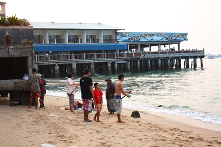 The entire family turns out for a day of fishing at the site where the old Pattaya pier once stood.