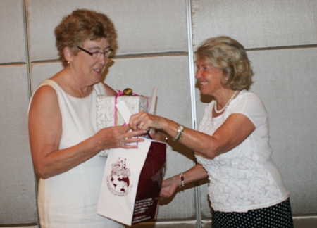 Outgoing president, Ann Winfield, accepts a thank-you gift from Kirsten Lillelund.