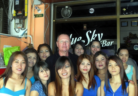 Dan 'The Diet Whiskey Man' (rear-center) celebrates his win with the staff at Blue Sky Bar.