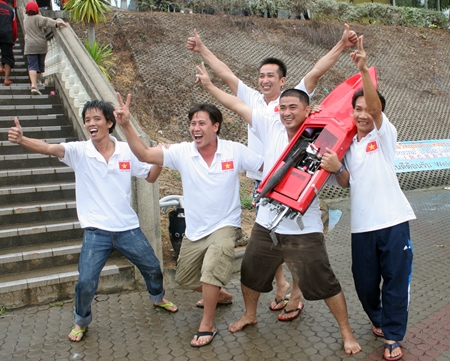 The Vietnam team celebrate after winning the Class G category.