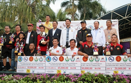 Class winners and runners-up pose with their trophies alongside city dignitaries and tournament officials.