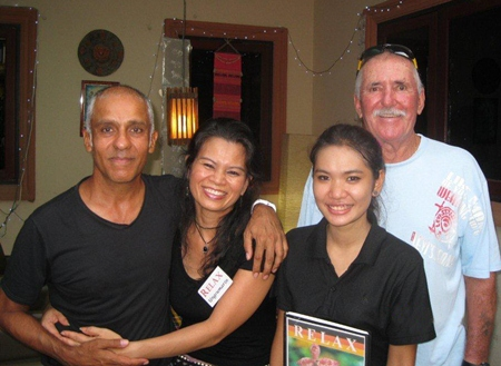 Mukesh Thakker and Bob Neylon pose with the staff at The Relax Bar.